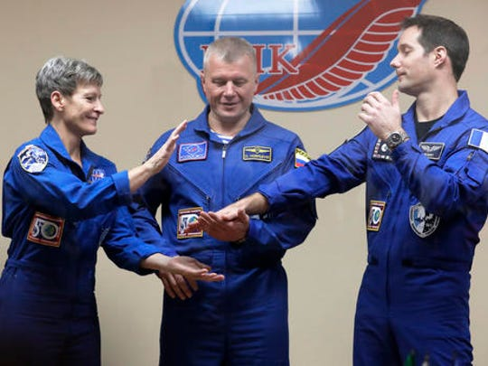 French astronaut Thomas Pesquet, right, Russian cosmonaut Oleg Novitsky, centre, and U.S. astronaut Peggy Whitson, members of the main crew to the International Space Station (ISS), pose after a news conference in Russian leased Baikonur cosmodrome, Kazakhstan, Wednesday, Nov. 16, 2016. The start of the new Soyuz mission to the International Space Station (ISS) is scheduled on early Friday, Nov. 18 local time.
