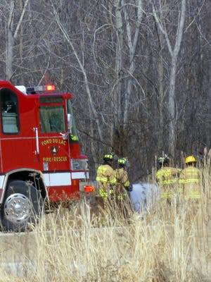 Fond du Lac firefighters put out a grass fire in April 2014.