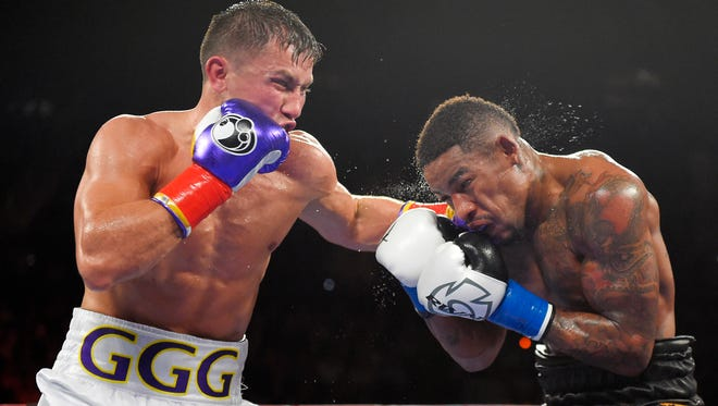Gennady Golovkin, left, of Kazakhstan, connects with Willie Monroe Jr. during a middleweight world championship bout.
