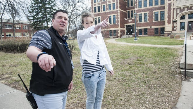 Detective Cory Reeves listens to Paige, a Paris Gibson Senior, describe where she saw the suspect jump the fence outside of The Ursuline Centre on Thursday.