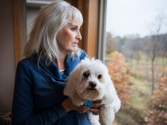 Dawn Swanson at home with her dog CJ in Plymouth, Minn., on October 31, 2016. Swanson has been taking medical cannabis for pain and seizures and is hoping her dog, who also has seizures, can be prescribed medical cannabis in the future as well.