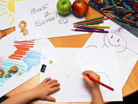 generic-young-student-school-homework.JPG