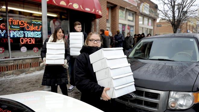Catherine Jagiello of Woodhaven leaves the New Palace Bakery on Joseph Campau with 5 dozen paczki.