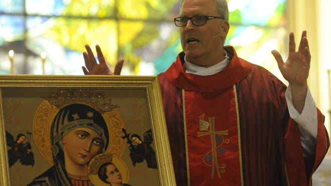 Rev. Eric Swearingen, pastor of the Catholic Church of Visalia, gives a homily during the Feast of Our Lady of Perpetual Help June 28, 2014, at St. Mary's Catholic Church. He is the new pastor of the Catholic Church of Visalia.