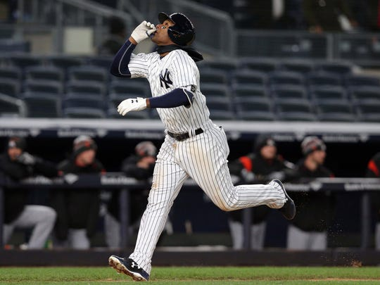 New York Yankees third baseman Miguel Andujar rounds the bases after hitting his first home run in the majors.