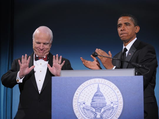 Then President-elect Barack Obama applauds Arizona Sen. John McCain, the former Republican presidential candidate, during a bipartisan dinner in McCain's honor on Jan. 19, 2009, in Washington, D.C., on the night before Obama's inauguration as the 44th president of the United States.