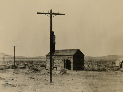 """The body of William """"Red"""" Wood hangs from a telegraph"""