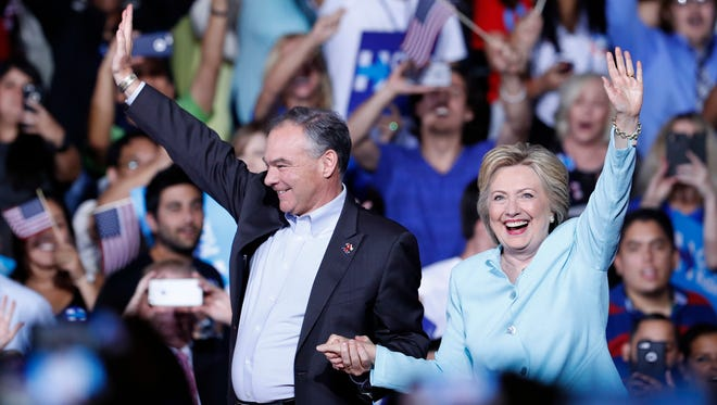 Democratic presidential candidate Hillary Clinton and Sen. Tim Kaine, D-Va., arrive at a campaign rally at Florida International University Panther Arena in Miami, Saturday, July 23, 2016. Clinton has chosen Kaine to be her running mate. (AP Photo/Mary Altaffer)