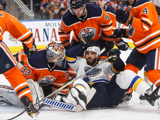 St. Louis Blues' Chris Thorburn (22) crashes into Edmonton Oilers goalie Cam Talbot (33) during the first period of an NHL hockey game Thursday, Dec. 21, 2017, in Edmonton, Alberta. (Jason Franson/The Canadian Press via AP)