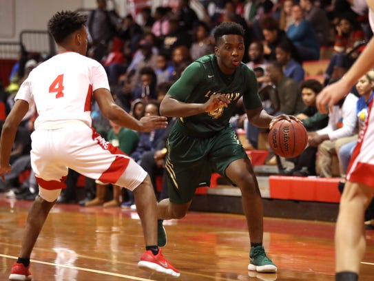 Lincoln's Trinton Bryant Jr. drives past Leon's Donovan