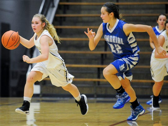 Boonville's Makenzie Mason (11) drives past Memorial's Mallory Wittmer (22) during their game at Boonville High School, Friday, Nov. 18, 2016.