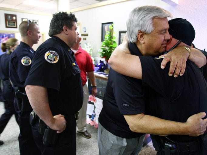 West Memphis Chief of Police Bob Paudert is comforted