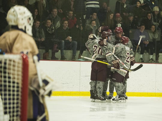 Norwich celebrates a goal during the men's hockey game between Norwich and St. Michael's at Cairns Arena on Saturday afternoon February 11, 2017 in South Burlington.