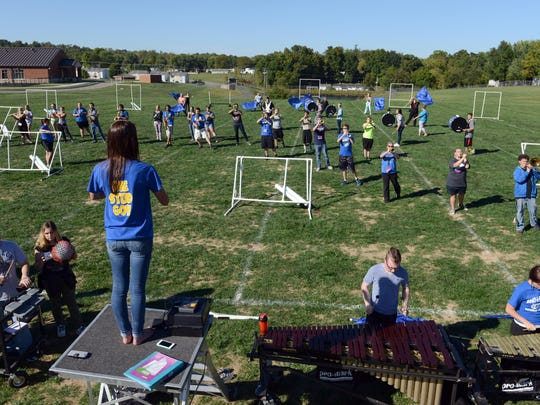 Sheridan Wilson, field commander, leads the Maysville High School marching band during a practice in preparation for the Buckeye Invitational. More than 30 high school bands will compete at the contest held at Ohio State University's Ohio Stadium.