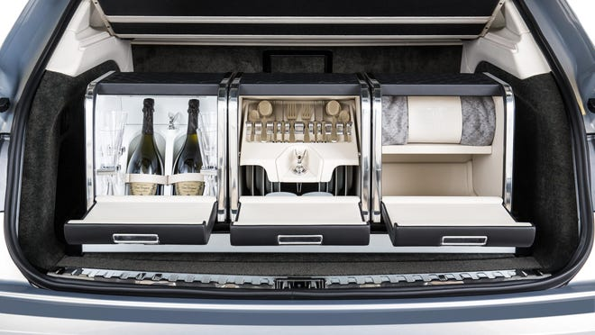 The Bentayga has a picnic set option and a rear seat that has a slide-out for sitting down at a table.