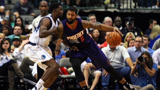 Oct. 21, 2015; Dallas; Phoenix Suns forward Markieff Morris  dribbles as Dallas Mavericks forward Jeremy Evans defends during the second quarter at American Airlines Center.