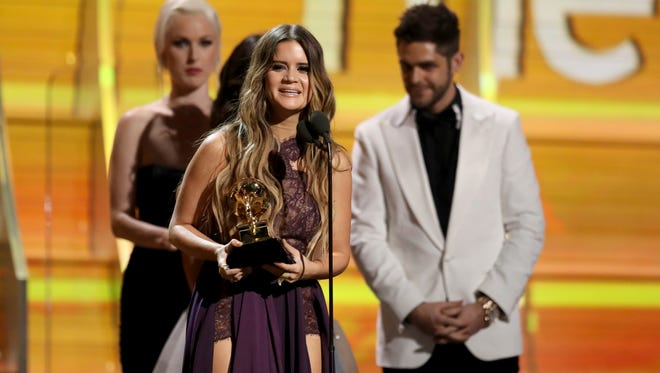 "Maren Morris accepts the award for best country solo performance for ""My Church"" at the 59th annual Grammy Awards on Sunday, Feb. 12, 2017, in Los Angeles. (Photo by Matt Sayles/Invision/AP)"