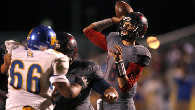 Wakulla quarterback Feleipe Franks makes a pass to Keith Gavin for a touchdown during a playoff win two weeks ago.
