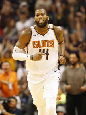 Phoenix Suns center Greg Monroe (14) runs back on defense during the fourth quarter against the Milwaukee Bucks at Talking Stick Resort Arena in Phoenix, Ariz. November 22, 2017.