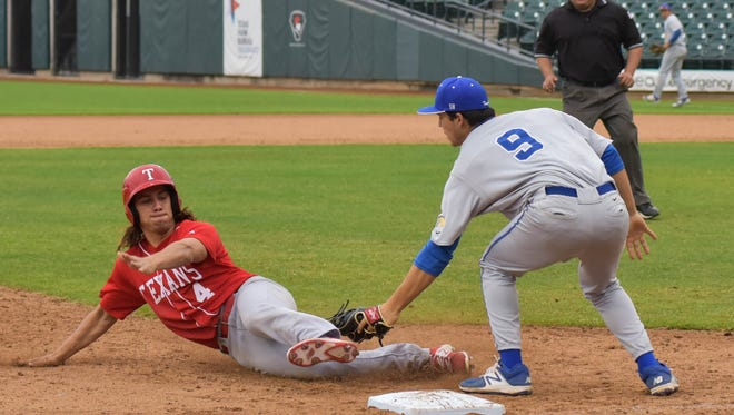 Ray's Chris Biddy is tagged out at third base by Moody's Alec Martinez on March, 04, 2017 at Whataburger Field.