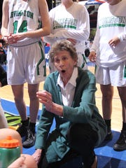 Irvington head coach Gina Maher talks to her players