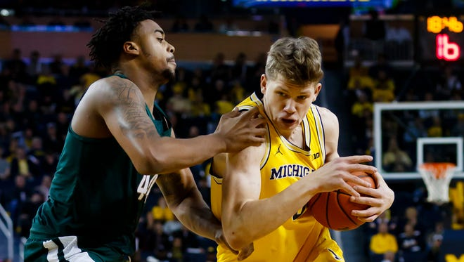 Michigan's Moritz Wagner, right, and Michigan State's Nick Ward are two players to watch during this Big Ten basketball season.