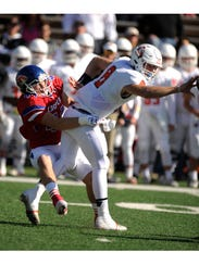 Cooper linebacker Richard Drew (44) hits Aledo quarterback