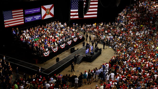 President Donald Trump speaks during a campaign rally at Florida State Fairgrounds Expo Hall, Tuesday, July 31, 2018, in Tampa, Fla.