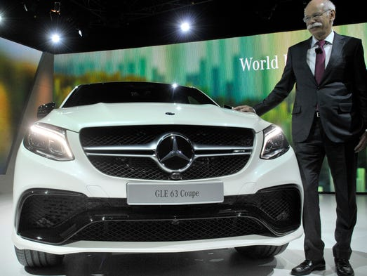 Dieter Zetsche, CEO of Mercedes, shows off the  new