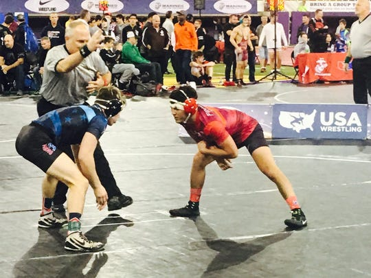 Saul Ervin in Red competes in the finals of the USAW Preseason Nationals. Ervin won the 138 lb division by defeating Jacob Dado of Marist, Illinois in the championship match.