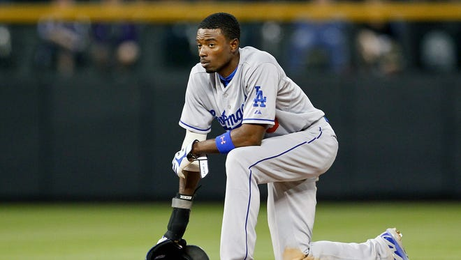 Los Angeles Dodgers second baseman Dee Gordon (9) in the sixth inning against the Colorado Rockies at Coors Field.