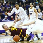 ASU's Kelsey Moos dives for possession against Washington on Friday during a 68-61 Sun Devil win.