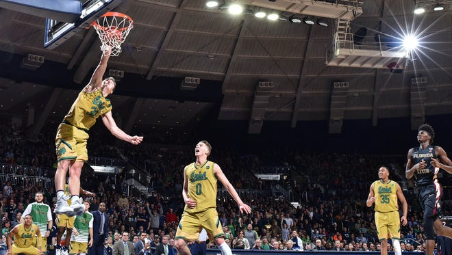 Feb 11, 2017; South Bend, IN, USA; Notre Dame Fighting Irish guard Steve Vasturia (32) dunks in the second half against the Florida State Seminoles at the Purcell Pavilion. Notre Dame won 84-72. Mandatory Credit: Matt Cashore-USA TODAY Sports