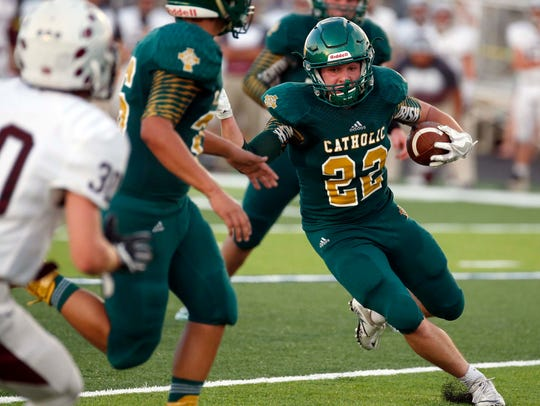 Springfield Catholic's Nick Crites smashed into the end zone to put Catholic back in front with four minutes to play in Friday night's season opener against Seneca.