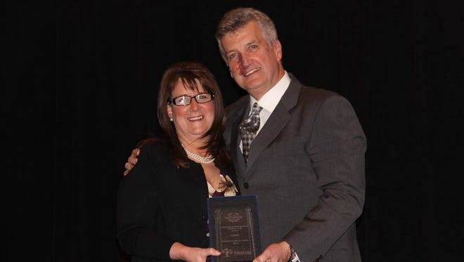 Brenda Johnston of Maryville is given a 2014 President's Circle of Honor award from Steve Monahan, president and CEO, Meemic Insurance Company.