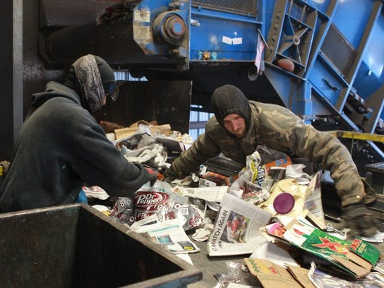Workers sorting through materials to separate recyclable and non-recyclable items at San Angelo's Butts Recycling Inc. Photo credit: Michelle Gaitan/San Angelo Standard-Times