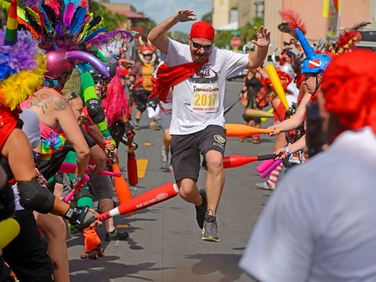 Runners head to the finish line Saturday, July 15,