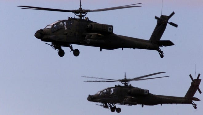 This file photo shows AH-64 Apache Attack helicopters at Fort Bragg, N.C., on Sep, 25, 2001.