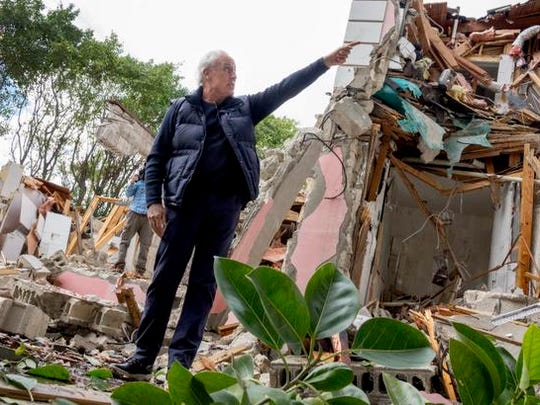 epa05111730 Christian de Berdouare, current owner of the mansion once owned by Colombian drug lord Pablo Escobar, looks on as the property is demolished, in Miami Beach, Florida, USA, 19 January 2016. The waterfront mansion was owned by Escobar in the early 1980's before it was seized by the U.S. government in 1987.  EPA/CRISTOBAL HERRERA