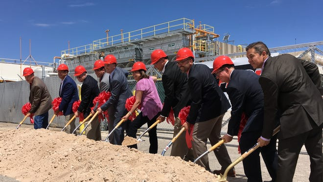 Gov. Susana Martinez, center, is joined by Sunland Park officials, state officials and Stampede Meat executives at a groundbreaking Friday, June 13, 2018 at a former Tyson Foods plant.