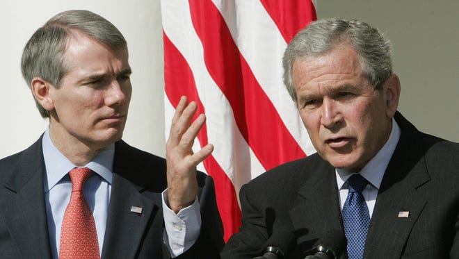George W. Bush (right) and Terrace Park's Rob Portman at the White House in 2006.
