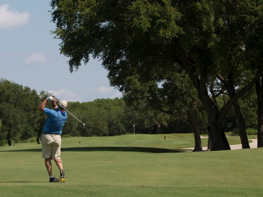 Sandy Davison takes aim at Shadow Wood Country Club, one of Southwest Florida's multitude of golf course communities.