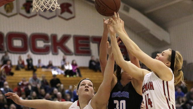 Nicole Marquardt (left) and Rachel Resch of Neenah fight for the ball with Maddie Fuller of Oshkosh West in recent FVA girls' basketball action.