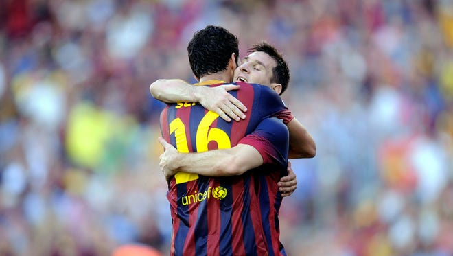 FC Barcelona's Lionel Messi, from Argentina, right, reacts after scoring a penalty against Levante during a Spanish La Liga soccer match at the Camp Nou stadium in Barcelona, Spain, Sunday.