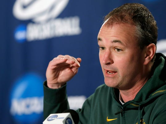 FILE - In this March 21, 2014 file photo, North Dakota State head coach Saul Phillips speaks at a news conference before the third round of the NCAA men's college basketball tournament in Spokane, Wash. Ohio University announced Sunday, April 6, 2014, it had hired Phillips , who led NDSU to a record-tying 26 wins this past season and a trip to the NCAA Tournament. (AP Photo/Elaine Thompson, File)