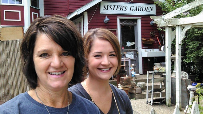 Barb Hochstetler and her daughter, Britt Wilson, took a break recently at Sisters Garden and Bloom, the two rural gift shops north of Kalona now celebrating 20 years of business.