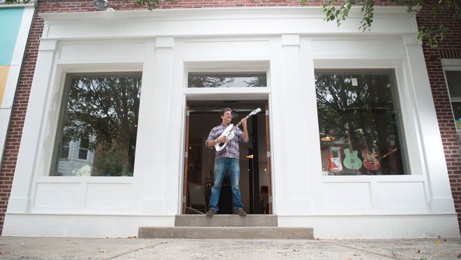 Ted Velykis, owner of the Collingswood Music store, stands in front of the new location of his store located on Lincoln Avenue in Collingswood.  09.08.14