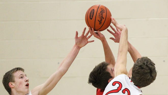 Beechwood's Ben Toebbe and Cole Hicks try to block a shot by St. Henry's Adam Goetz.