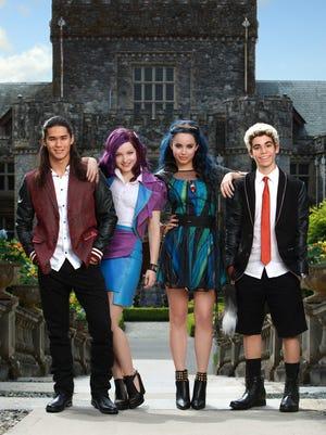 "The teenage kids of iconic Disney villains — Jay (Booboo Stewart), left, Mal (Dove Cameron), Evie (Sofia Carson) and Carlos (Cameron Boyce) —get the spotlight in the Disney Channel movie, ""Descendants."""