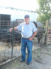Chris Petersen of Clear Lake farms and raises pigs